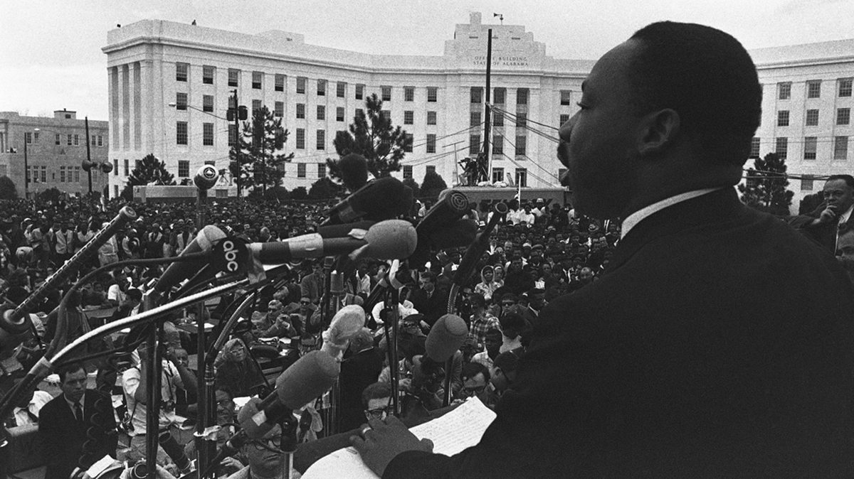 Dr. Martin Luther King addresses a crowd in Montgomery, Ala., on March 25, 1965, calling for continued protests against voting discrimination against African Americans. The rally climaxed a five-day civil rights march from Selma, Ala., starting Sunday, to Montgomery.