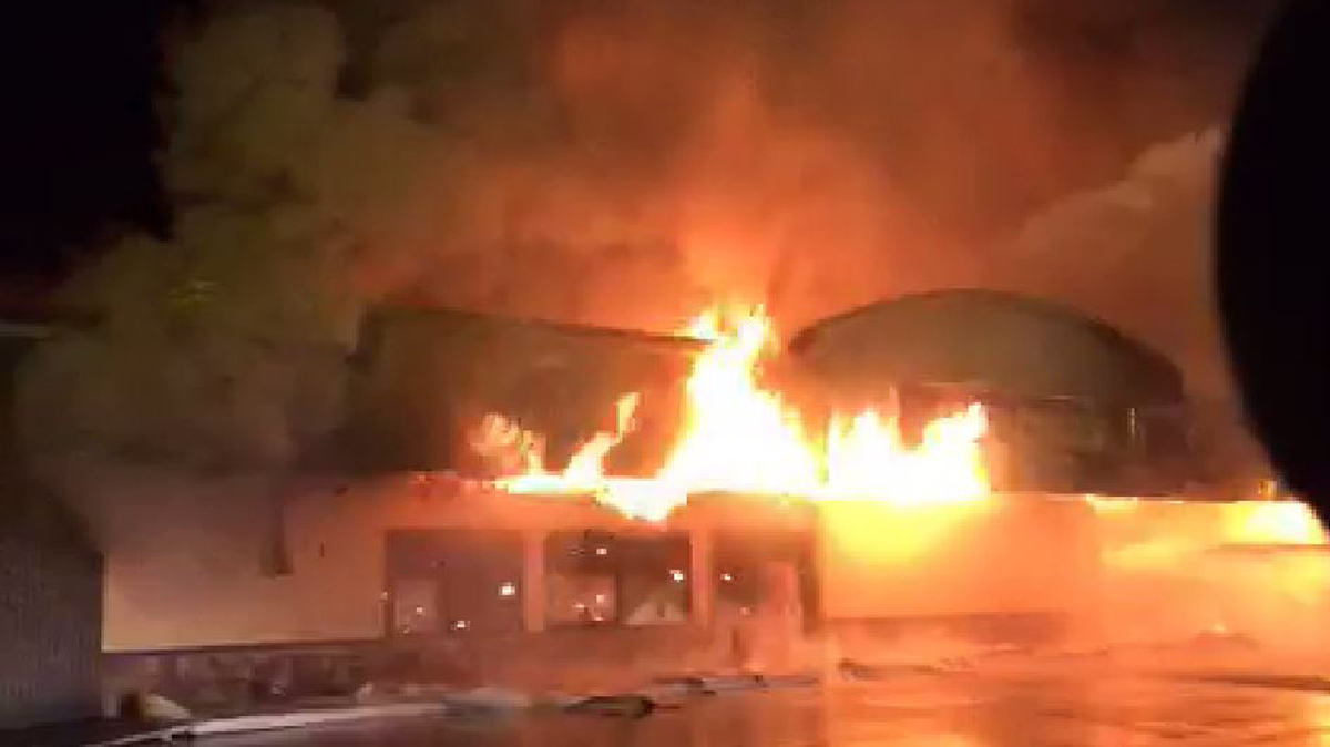 Drivers passing by the building noticed heavy smoke and called 911 around 3:55 a.m., according to the fire department.