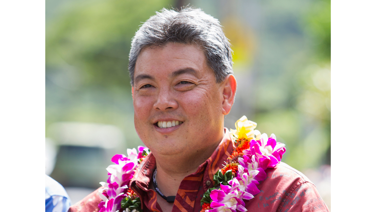 This Nov. 4, 2014, file photo shows then-Hawaii State Rep. Mark Takai doing some last minute campaigning for Congress on election day in Honolulu. Takai was diagnosed with pancreatic cancer last year and died on Wednesday, July 20, 2016.