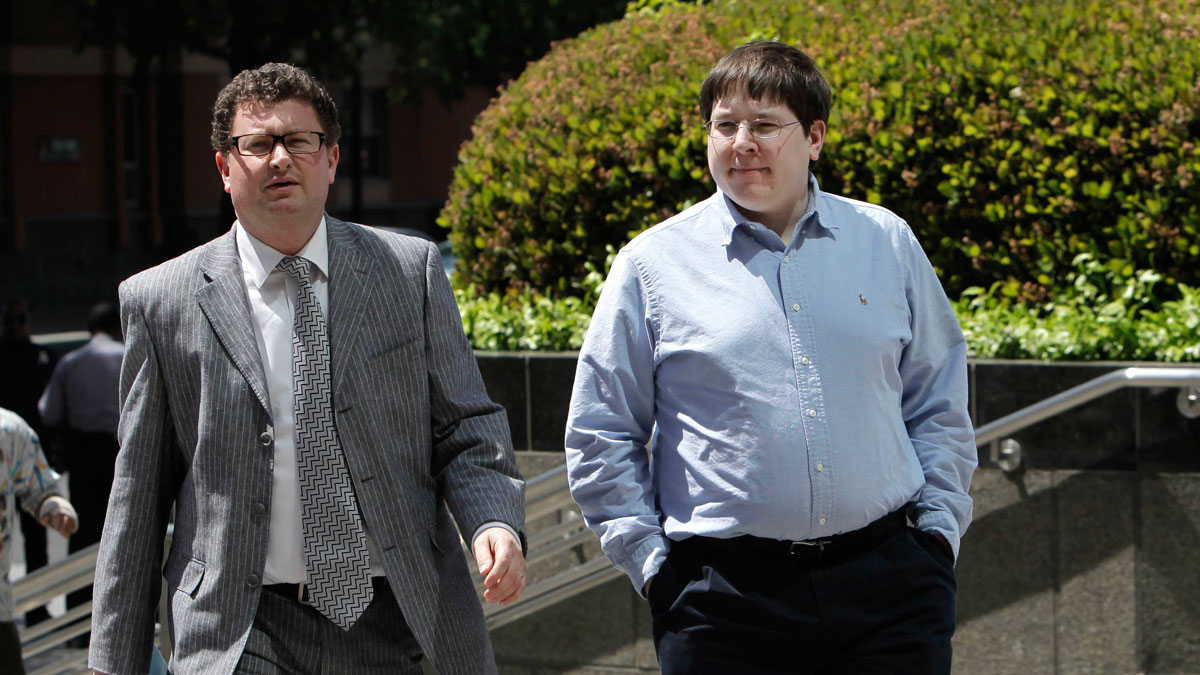 In this April 23, 2013 file photo, Matthew Keys, right, walks to the federal courthouse for his arraignment with his attorney Jason Leiderman, in Sacramento, Calif.
