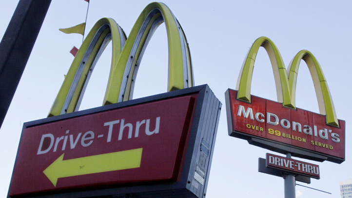 FILE - In this Dec. 20, 2010 file photo, McDonald's signs sprout from the restaurant's parking lot in New York. McDonald�s says a key sales figure edged up modestly in July, 2013, as the Dollar Menu and Big Macs in the U.S. helped offset declines in other parts of the world.  The world�s biggest hamburger chain says global sales rose 0.7 percent at restaurants open at least 13 months. That included a 1.6 percent increase in the U.S., where it said �everyday value offerings,� breakfast and staples such as the Big Mac drove up results.  (AP Photo/Richard Drew, file)