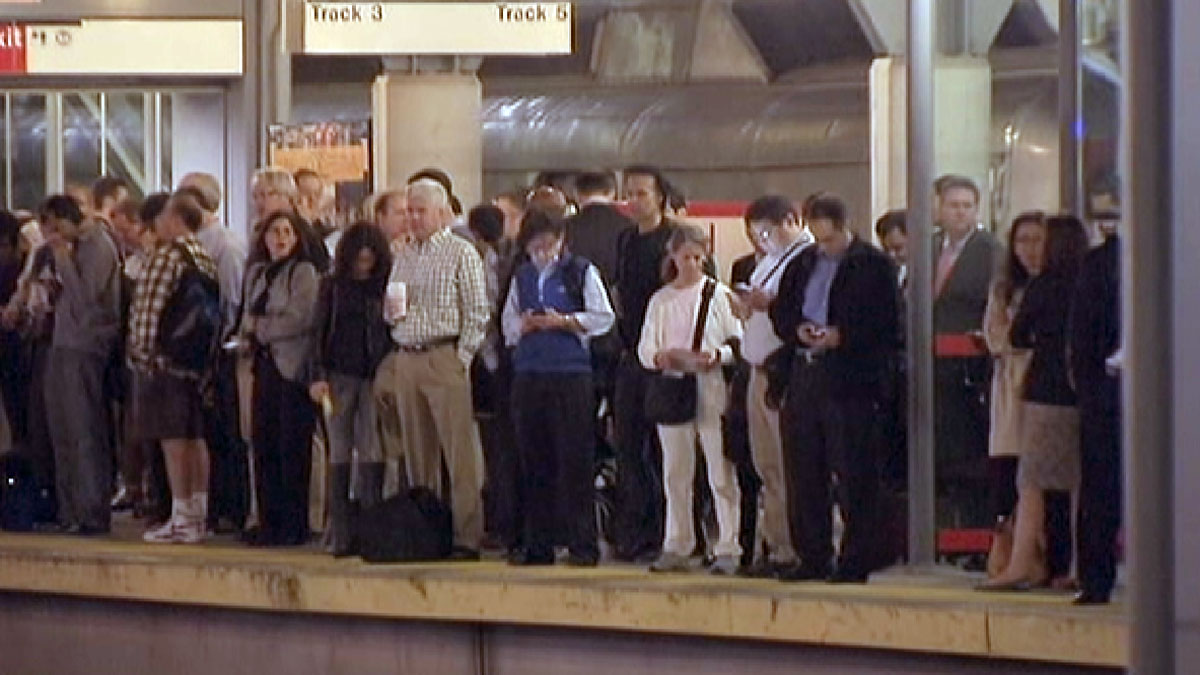 Commuters stand on a platform at the Stamford Metro-North station Thursday morning.