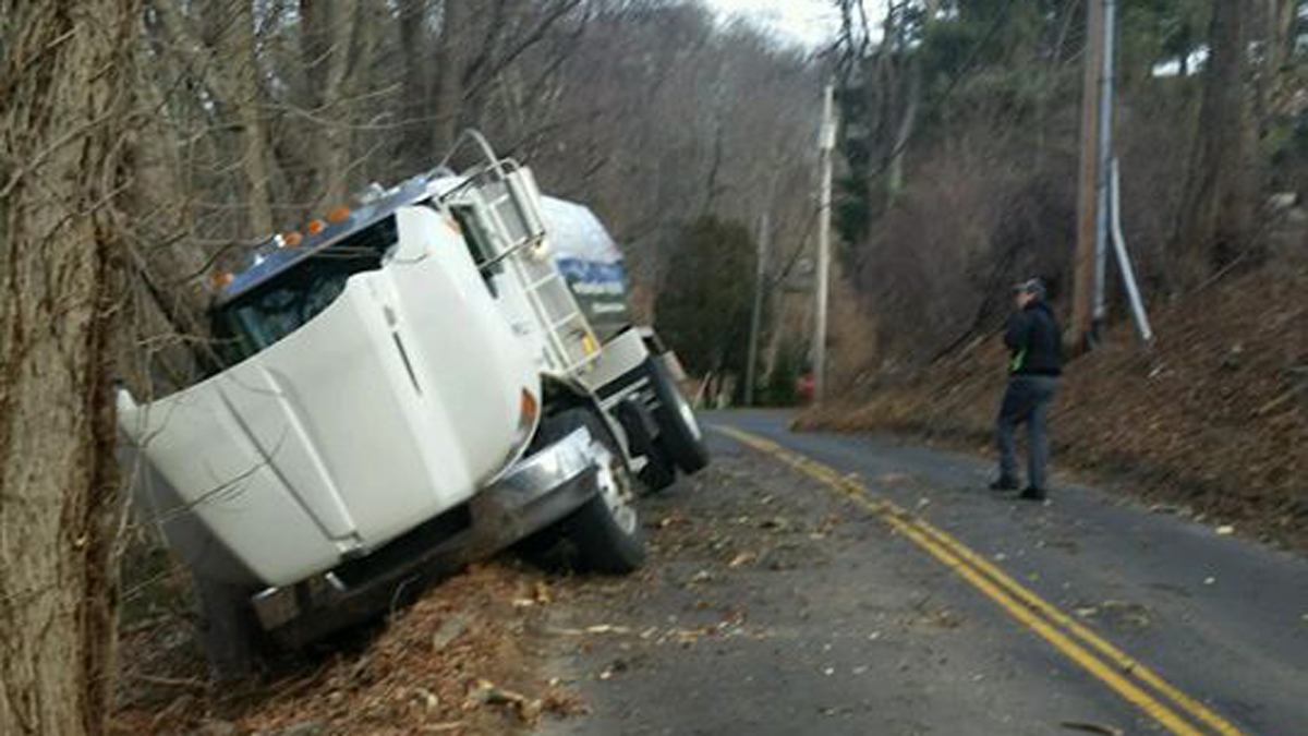 An oil delivery truck crashed on Judd Road in Monroe Monday and ruptured its fuel tank, spilling fuel in the area.