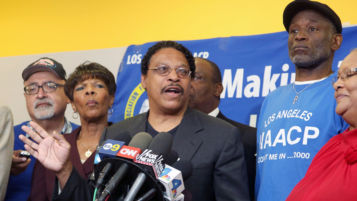 Leon Jenkins, center, president of the Los Angeles chapter of the NAACP, announces that Los Angeles Clippers owner Donald Sterling will not be receiving his lifetime achievement award, at a news conference in Culver City, Calif., Monday, April 28, 2014.