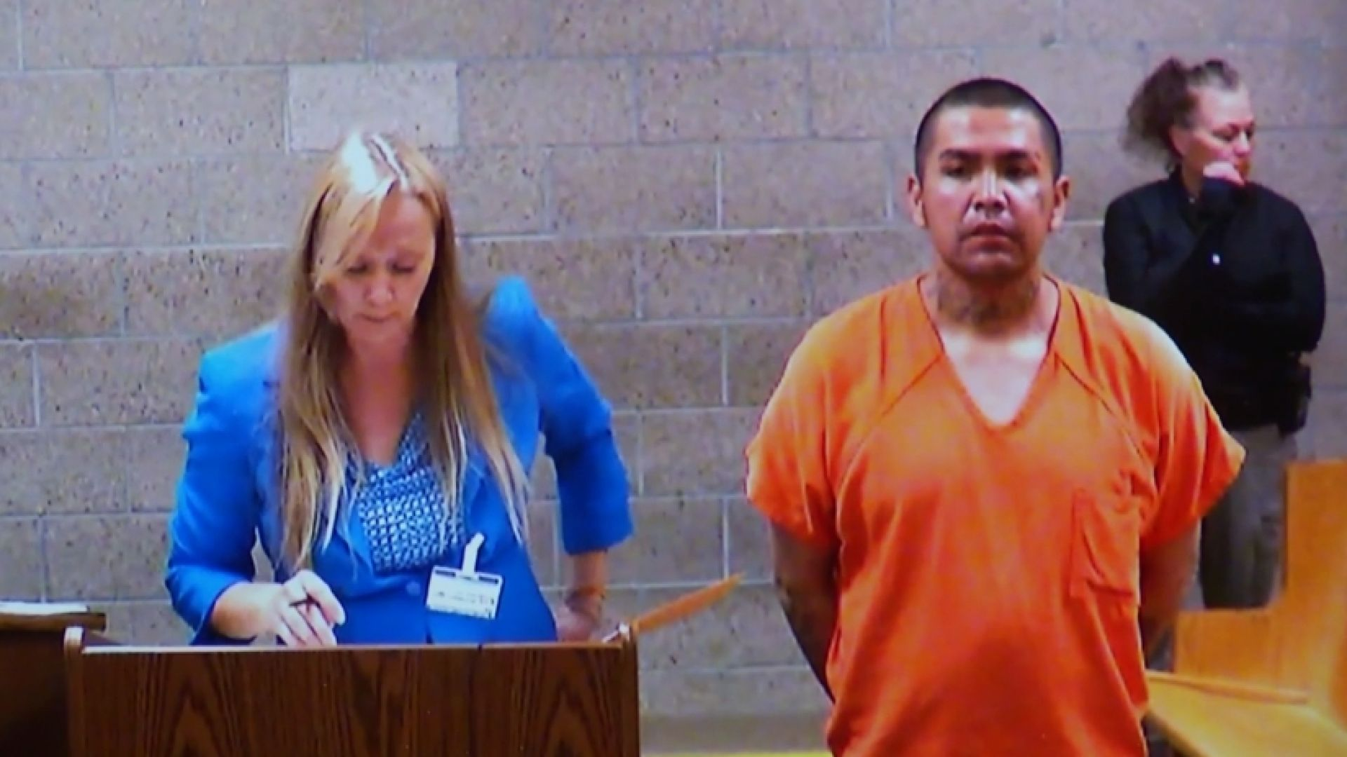 An Albuquerque woman said a complete stranger tried to take one of her children and run off when she wasn't looking.