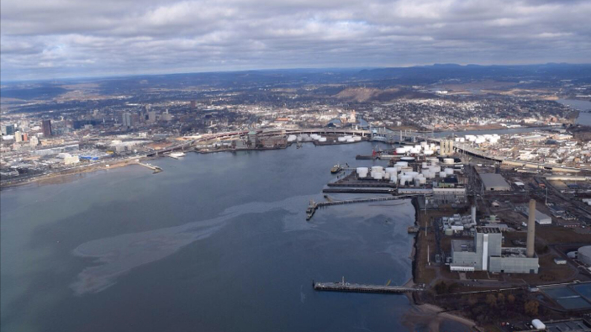 The US Coast Guard called in the Department of Energy and Environmental protection to investigate a sheen of oil in the New Haven harbor