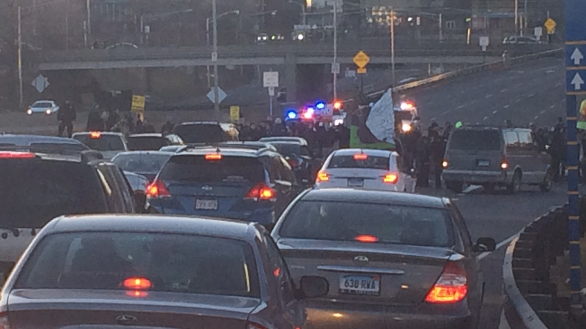 Protesters blocking traffic on Route 34 in New Haven Saturday afternoon.