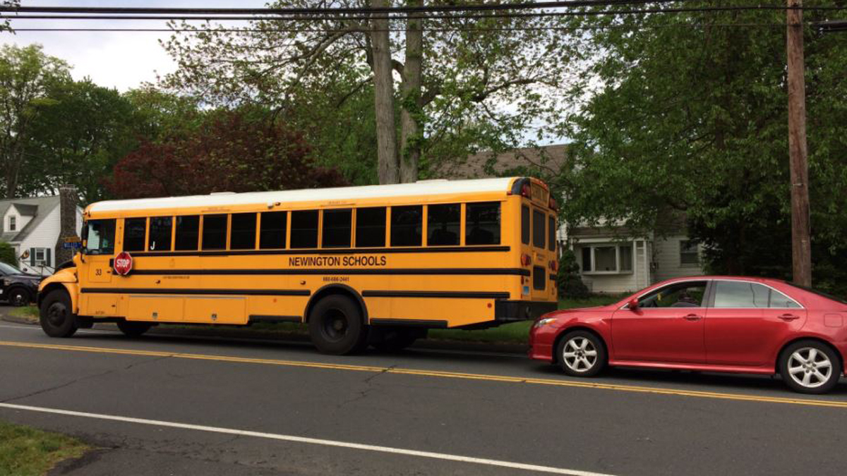 A school bus stopped to pick up a student was rear-ended by a car in Newington Tuesday morning, according to police.