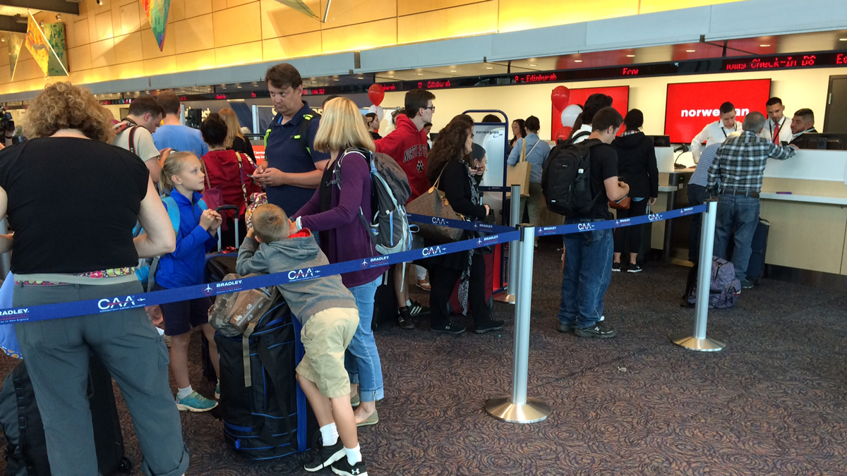 Travelers lined up for the first Norwegian Airlines flight from Bradley International Airport to Scotland.