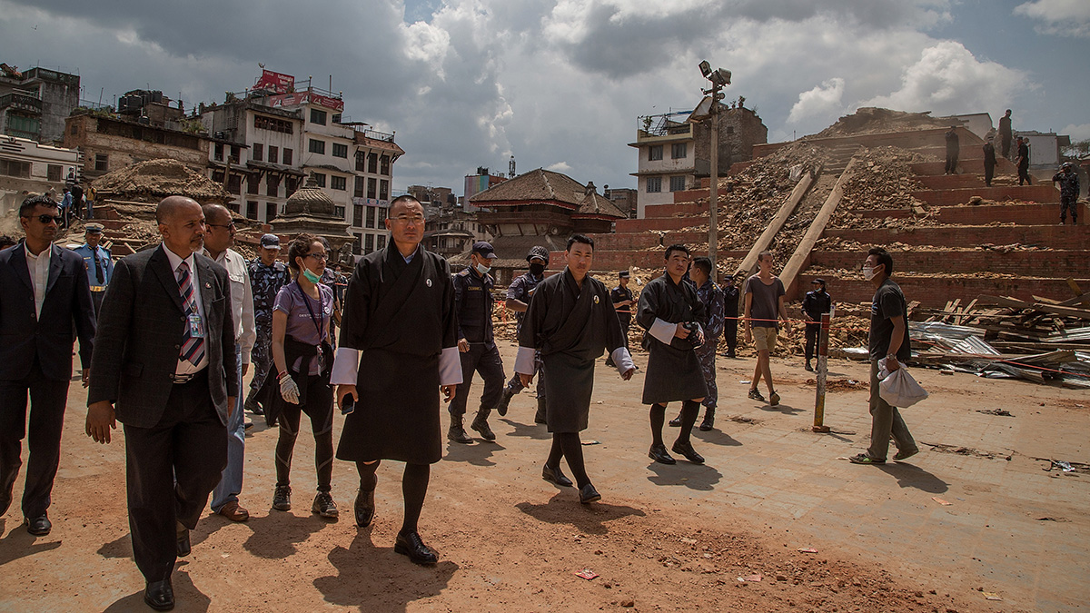 Bhutanese Prime Minister Tshering Tobgay visits the collapsed temples at Basantapur Durbar Square on April 27, 2015 in Kathmandu, Nepal. A major 7.8 earthquake hit Kathmandu mid-day on Saturday, and was followed by multiple aftershocks that triggered avalanches on Mt. Everest that buried mountain climbers in their base camps. Many houses, buildings and temples in the capital were destroyed during the earthquake, leaving over 2 thousand dead and many more trapped under the debris as emergency rescue workers attempt to clear debris and find survivors.  (Photo by Omar Havana/Getty Images)
