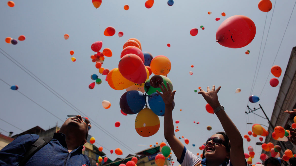 Nepalese people release balloons in memory of those who died in last year's quake in Kathmandu, Nepal, April 23, 2016.