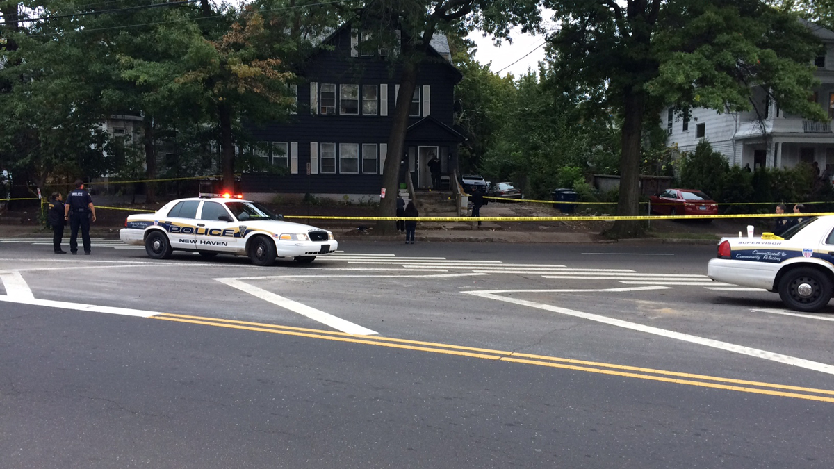 The scene on Derby Avenue in New Haven after two men were injured in a shooting Sunday afternoon.