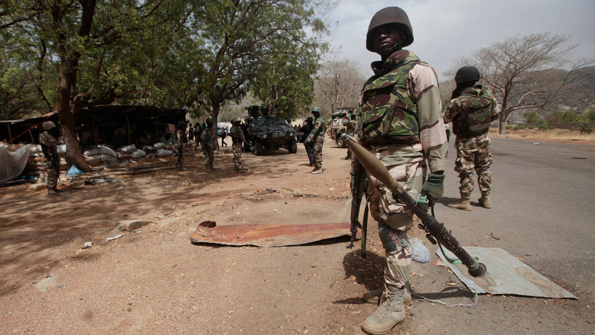 FILE - In this file photo taken Wednesday, April 8, 2015, Nigerian soldiers man a checkpoint in Gwoza, Nigeria, a town newly liberated from Boko Haram.