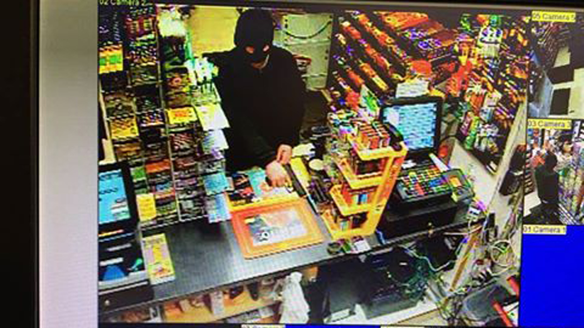 Surveillance video shows a male suspect robbing a clerk at the Shell Gas Station at 195 State Street in North Haven Tuesday, according to police.