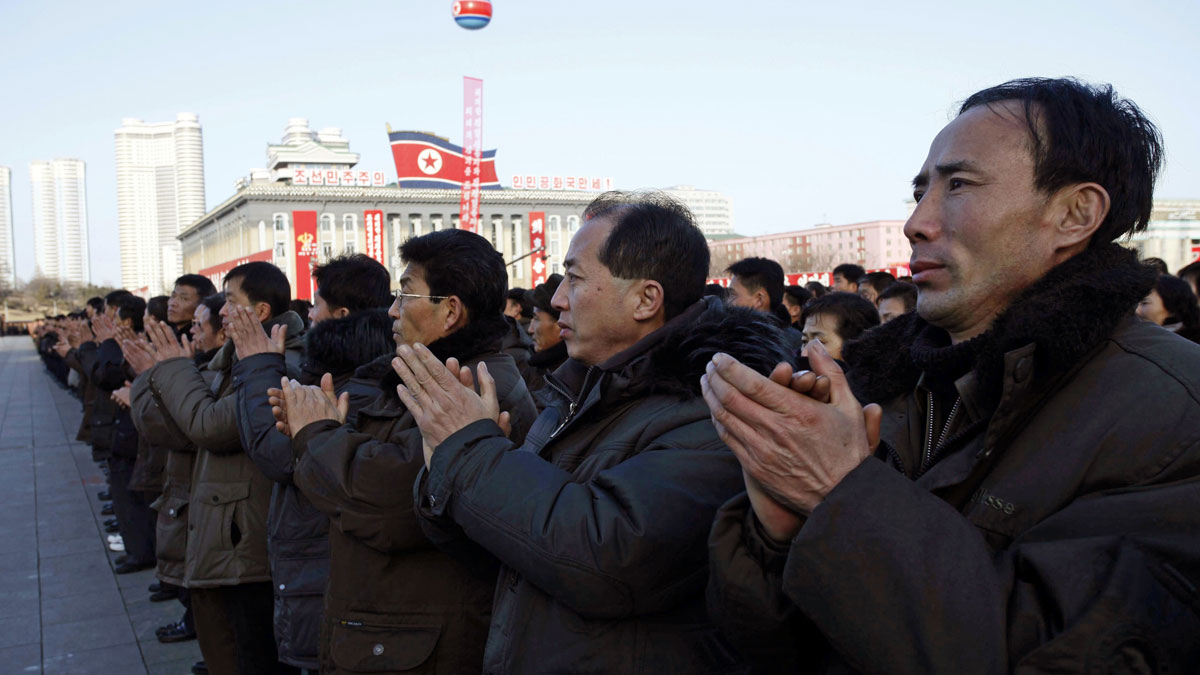 North Koreans clap hands together in a rally, after North Korea said it had conducted a hydrogen bomb test, at the Kim Il Sung Square in Pyongyang, Friday, Jan. 8, 2016.