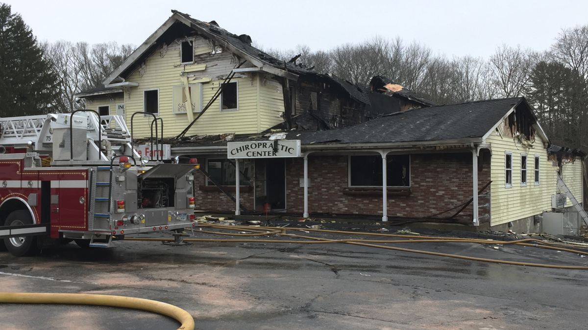 Norwich fire officials said the building on the corner of West Main Street and Banas Court was so heavily damaged by fire it will have to be torn down.