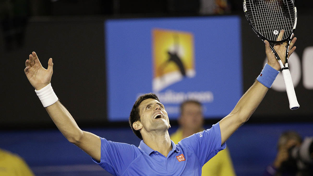 Novak Djokovic of Serbia celebrates after defeating Andy Murray of Britain in the men's singles final at the Australian Open tennis championship in Melbourne, Australia, Sunday, Feb. 1, 2015.