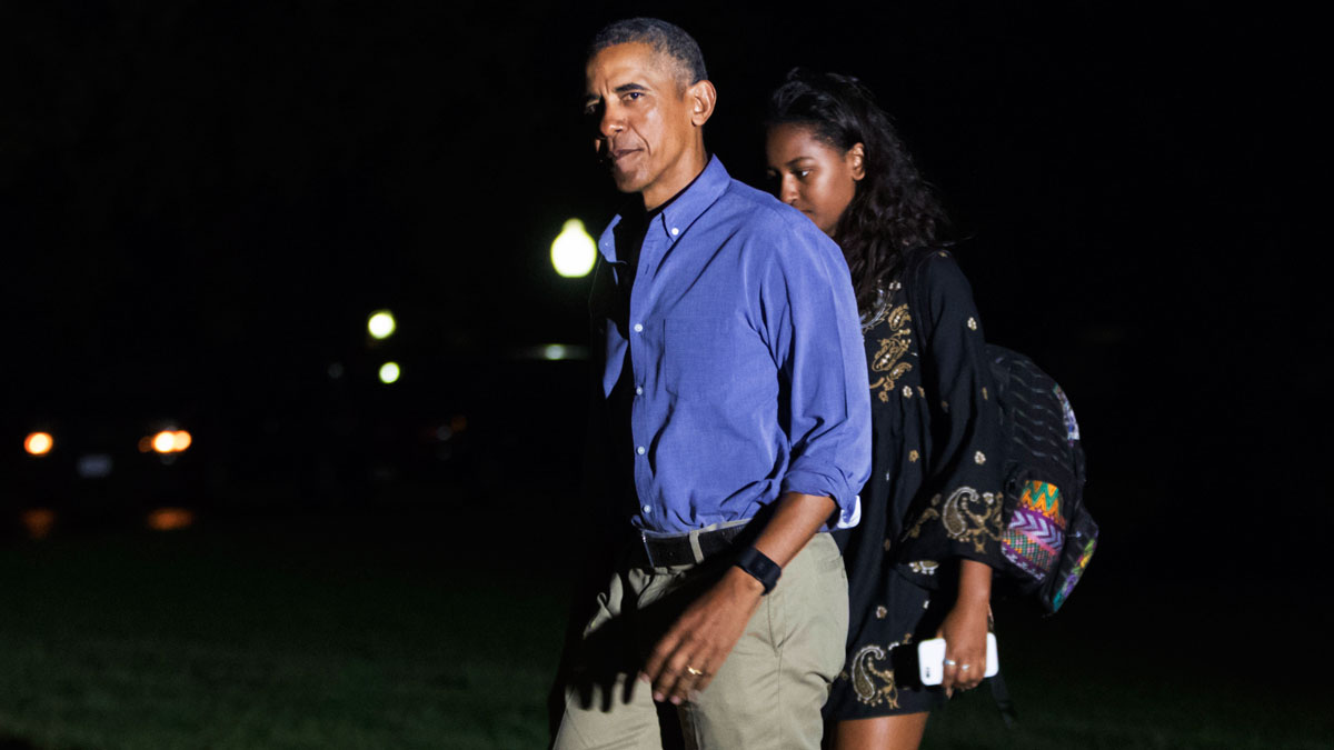 President Barack Obama, followed by daughter Sasha Obama, returns from a 16-day vacation to Martha's Vineyard, Mass., arriving at the White House in Washington, late Sunday, Aug. 21, 2016.