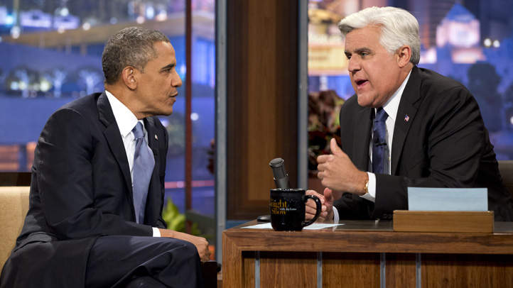 President Barack Obama, left, talks with Jay Leno during a commercial break during the taping of his appearance on The Tonight Show with Jay Leno.