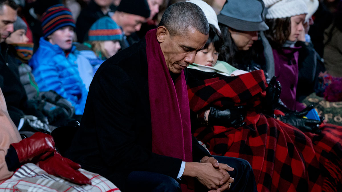President Barack Obama bows his head in prayer during the National Christmas Tree Lighting ceremony in Washington, D.C. on Thursday, Dec. 3, the day after 14 people were killed and 21 wounded in San Bernardino, California. The president will address the nation on Dec. 6 following the massacre.