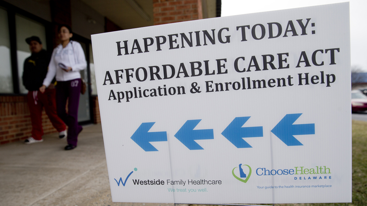 An Affordable Care Act application and enrollment help sign stood outside a Westside Family Healthcare center in Bear, Delaware, U.S., on Thursday, March 27, 2014.