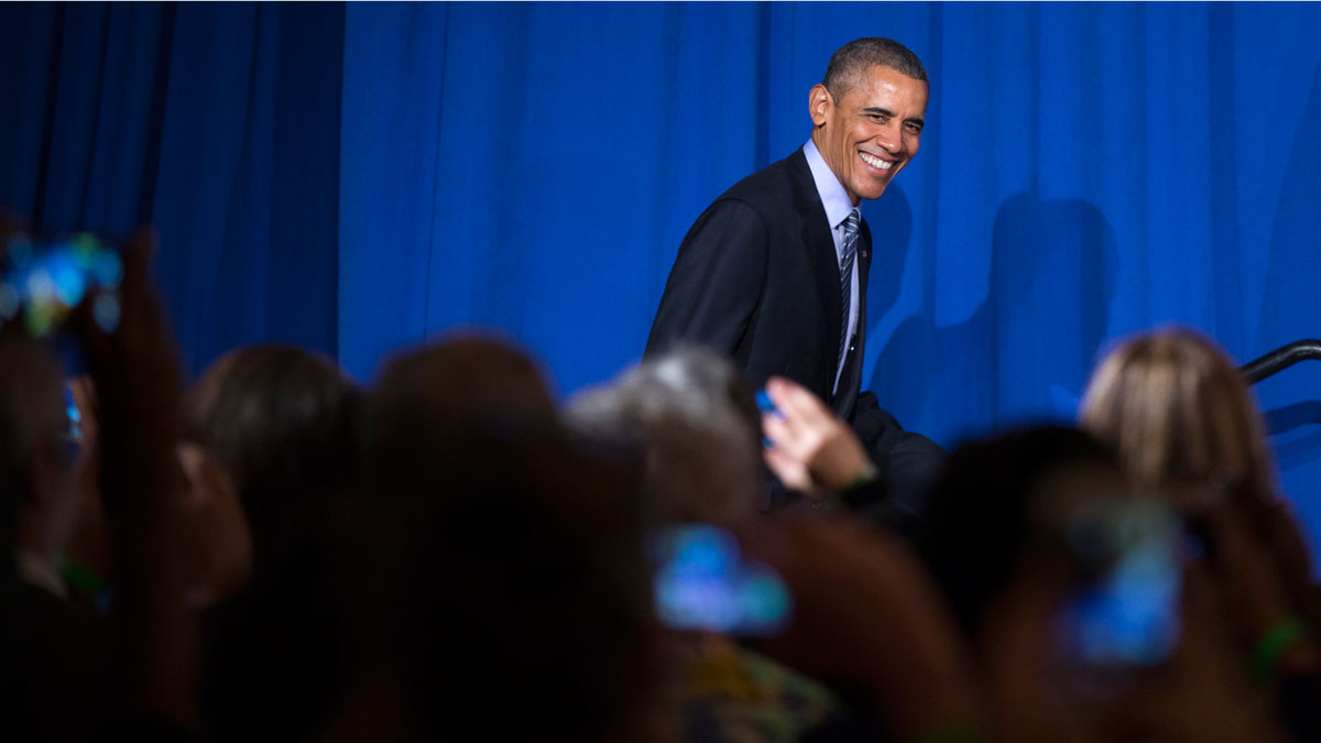 President Barack Obama smiles as he arrives to speak during a Organizing for Action event, on Monday, Nov. 9, 2015, in Washington. Obama thanked the organization for their work in promoting his policies.
