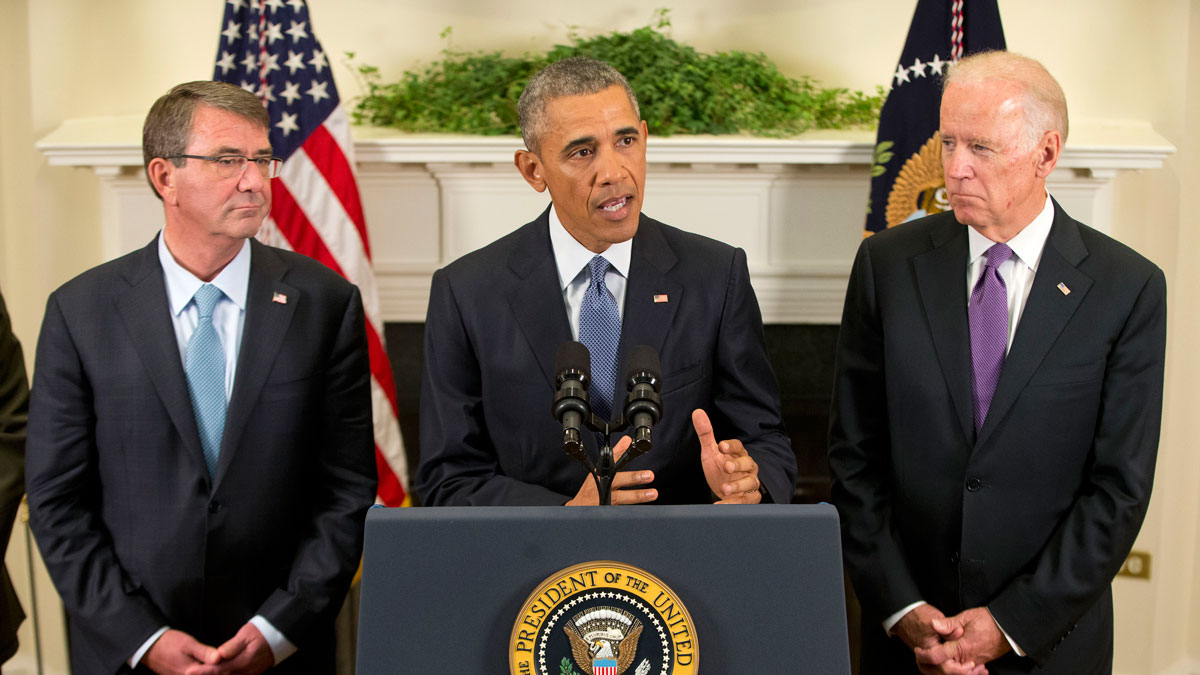 President Barack Obama, flanked by Vice President Joe Biden, right, and Defense Secretary Ash Carter, speaks about Afghanistan, Thursday, Oct. 15, 2015, in the Roosevelt Room of the White House in Washington. Obama announced that he will keep U.S. troops in Afghanistan when he leaves office in 2017, casting aside his promise to end the war on his watch and instead ensuring he hands the conflict off to his successor.