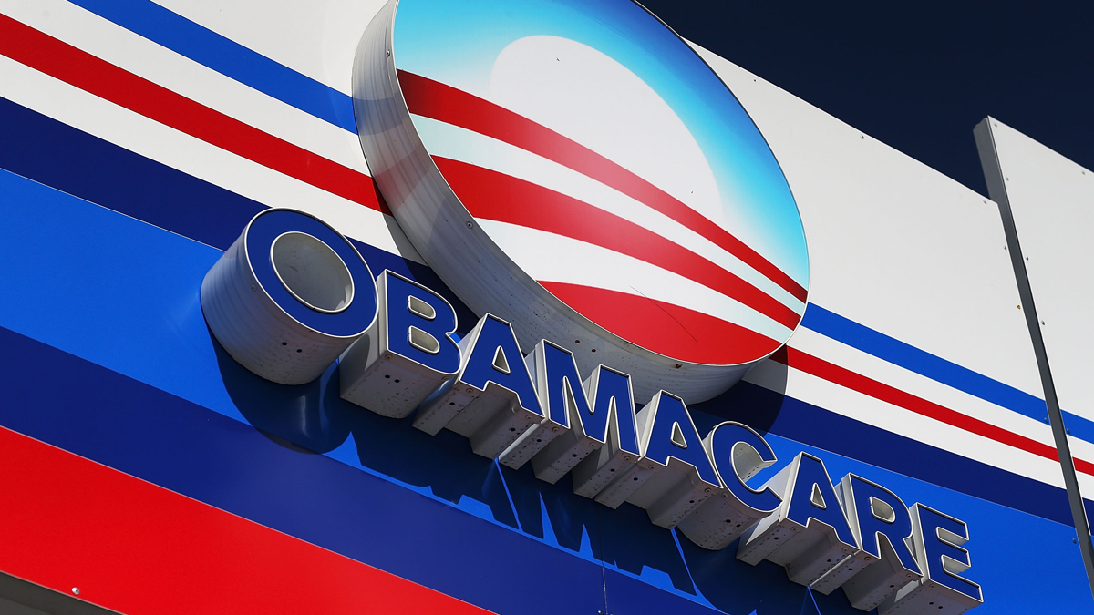 An Obamacare sign is seen on the UniVista Insurance company office in Miami, Florida.