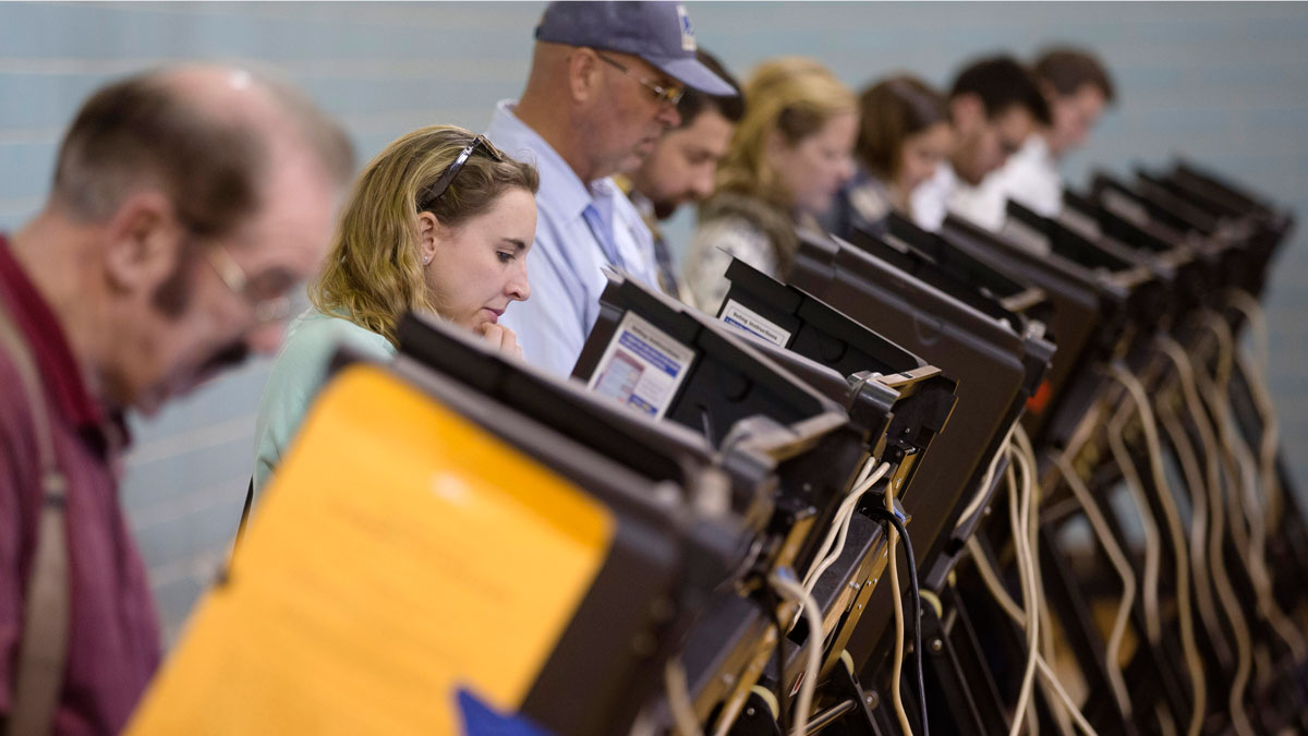 Voters use electronic voting machines at the Schiller Recreation Center polling station on election day, Tuesday, Nov. 3, 2015, in Columbus, Ohio. Eligible Ohioans headed to the polls Tuesday, to decide whether to make marijuana legal for both recreational and medical use.