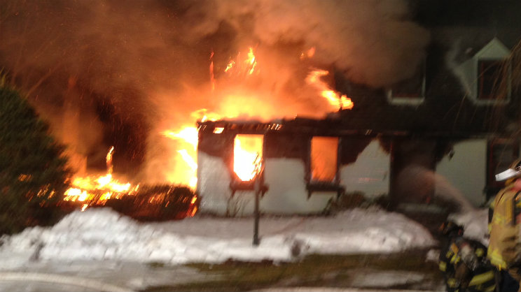 Flames shooting out of a home on Denmore Lane in Old Saybrook Sunday morning.