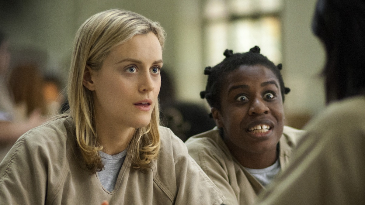 This image released by Netflix shows Taylor Schilling, left, and Uzo Aduba in a scene from