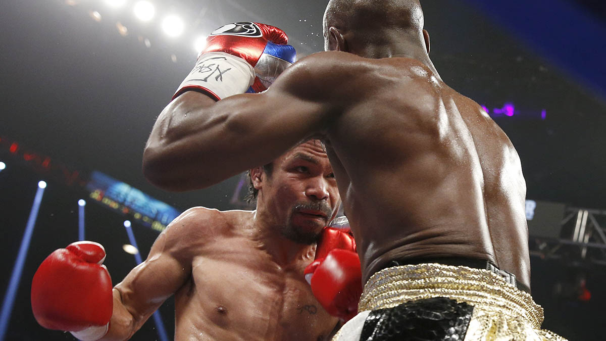 Manny Pacquiao, left, from the Philippines, trades blows with Floyd Mayweather Jr., during their welterweight title fight on Saturday, May 2, 2015 in Las Vegas.