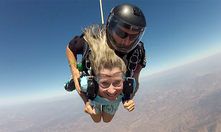 Shirley Vos, 65, skydives over San Diego on her 65th birthday on September 13, 2013. Her twin sister, Sharon Gebauer, also joined in on the airborne adventure.
