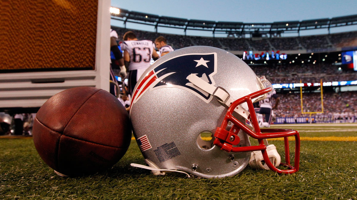 A New England Patriots helmet sits on the sideline next to a football during the first half of a preseason NFL football game between the New York Giants and the New England Patriots Wednesday, Aug. 29, 2012, in East Rutherford, New Jersey.