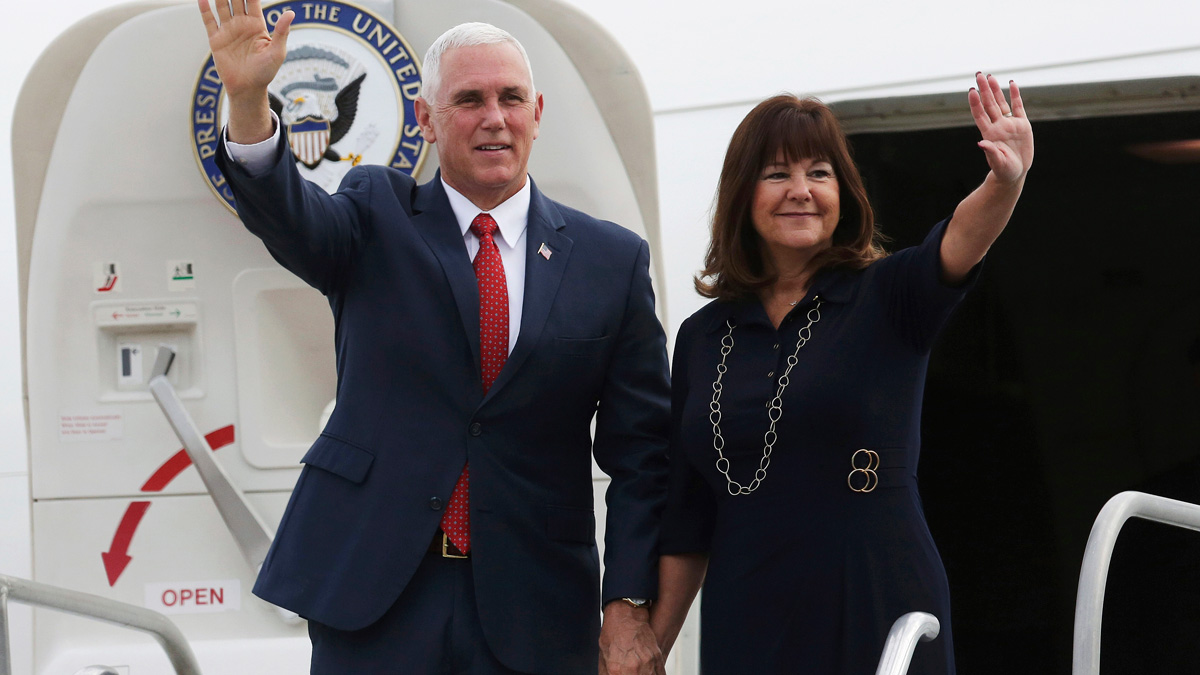In this June 26, 2018, file photo, U.S. Vice President Mike Pence, left, and his wife Karen Pence wave during their arrival at Brasilia Air Base, in Brasilia, Brazil.
