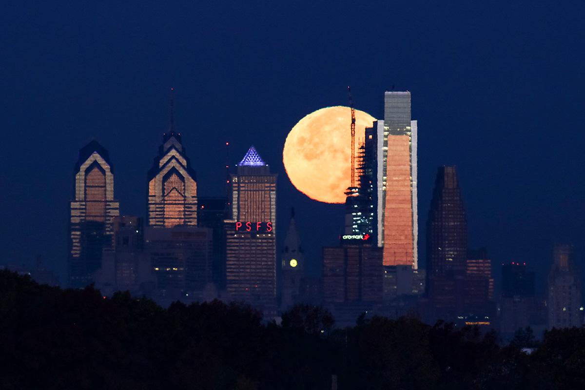 The supermoon sets behind the Philadelphia skyline on Nov. 14, 2016.