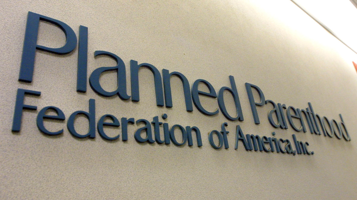 File - A sign hangs in the offices of the Planned Parenthood Federation of America December 7, 2001 in New York City.