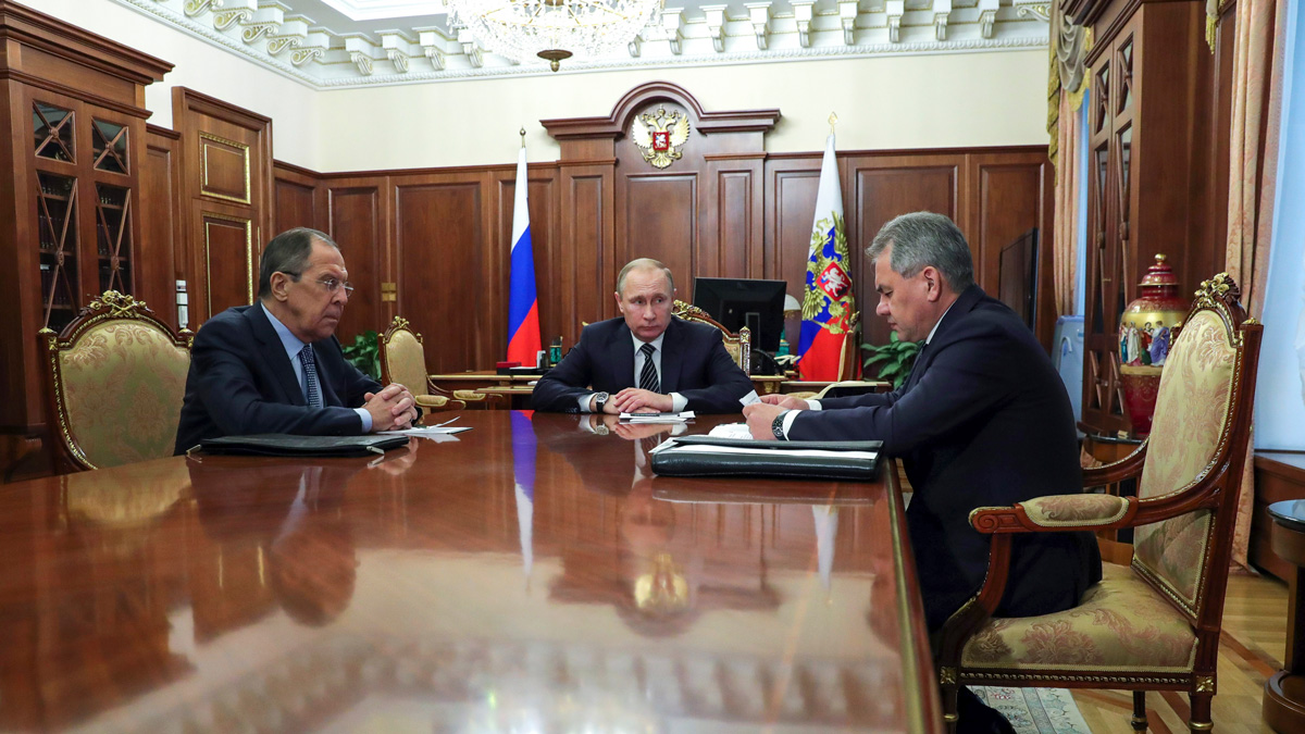 Russian President Vladimir Putin, center, and Foreign Minister Sergey Lavrov, left, listen to Defence Minister Sergei Shoigu in Moscow, Russia on Dec. 29, 2016.