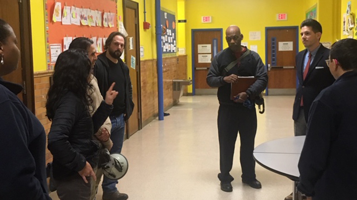 Protesters gathered at a Hartford Board of Education meeting Wednesday to protest the removal of Renzulli Gifted and Talented Academy administrator Freddie DeJesus.