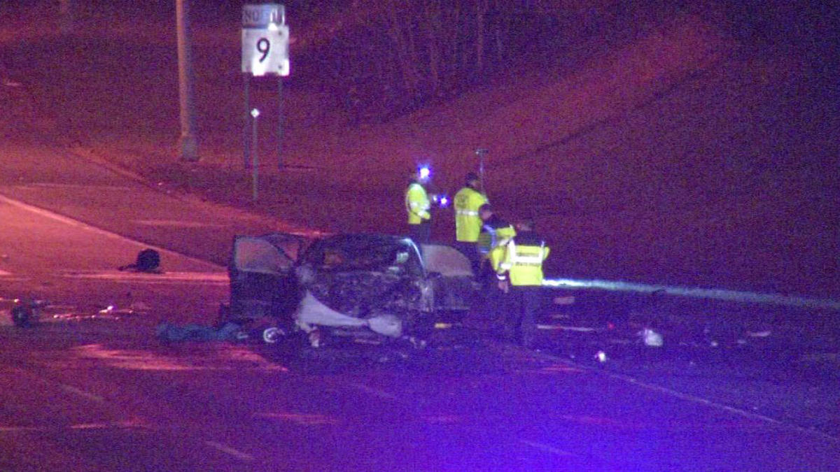 One person was killed in a fiery crash on Route 9 northbound in New Britain Sunday night. Here crews are seen with one of the vehicles.