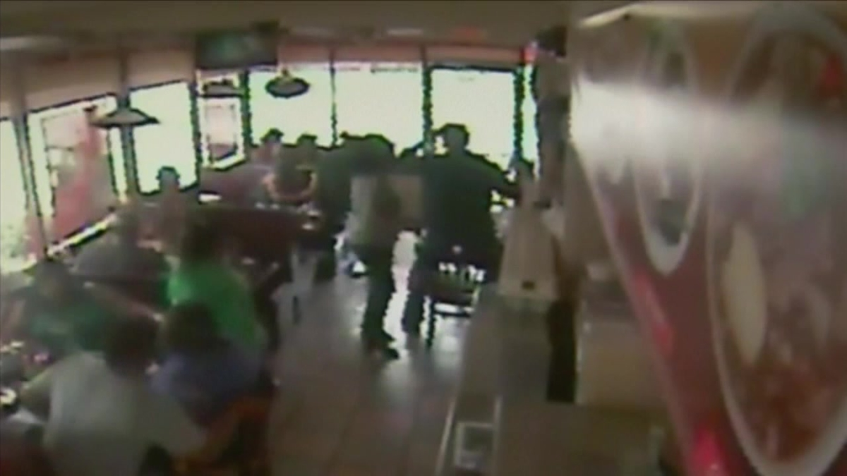 Customers leap from their seats as a tire crashes through a restaurant window Sunday June 28, 2015 in Santa Ana.