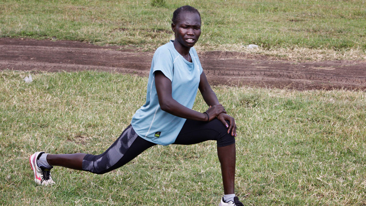 In this photo taken June 30, 2016, Rose Nathike Lokonyen stretches during a training session in Ngong, Kenya. Lokonyen is one of five runners from South Sudan that grew up in a refugee camp and are part of the IOC's first refugee team that will be competing at the Rio Olympics. The games will be broadcast to the refugee camp for the first time.