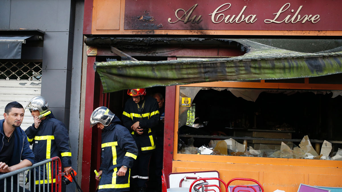 Firefighters leave after inspecting the damaged Au Cuba Libre bar in Rouen, northern France, on August 6, 2016, after a fire broke out overnight in the bar during a birthday party. At least 13 people were killed and six injured in the fire, officials said.