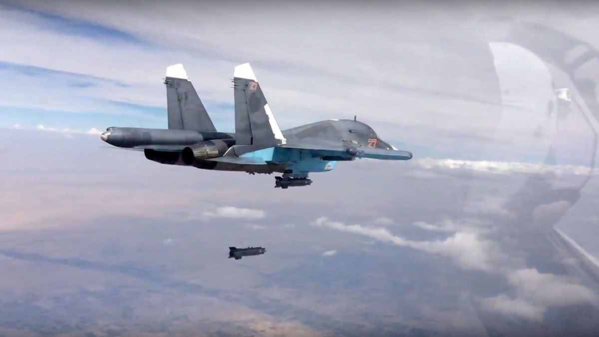 In this photo made from the footage taken from Russian Defense Ministry official website on Friday, Oct. 9, 2015, a bomb is released from Russian Su-34 strike fighter in Syria.