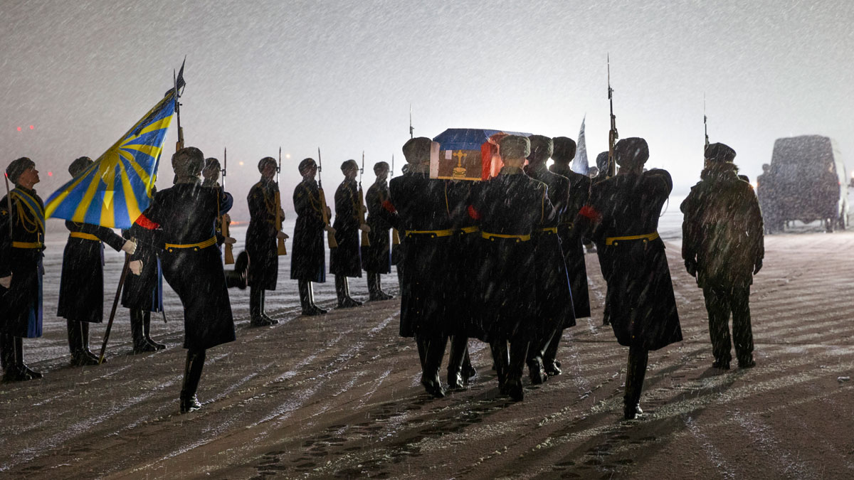 Russian honor guard carry the coffin with the body of Russian Lt. Col. Oleg Peshkov, after being transported from Turkey, at a mourning ceremony in Chkalovsky military airport outside Moscow, Monday, Nov. 30, 2015. Peshkov, a pilot of a Russian Su-24 bomber was killed after the warplane was downed by a Turkish fighter jet.
