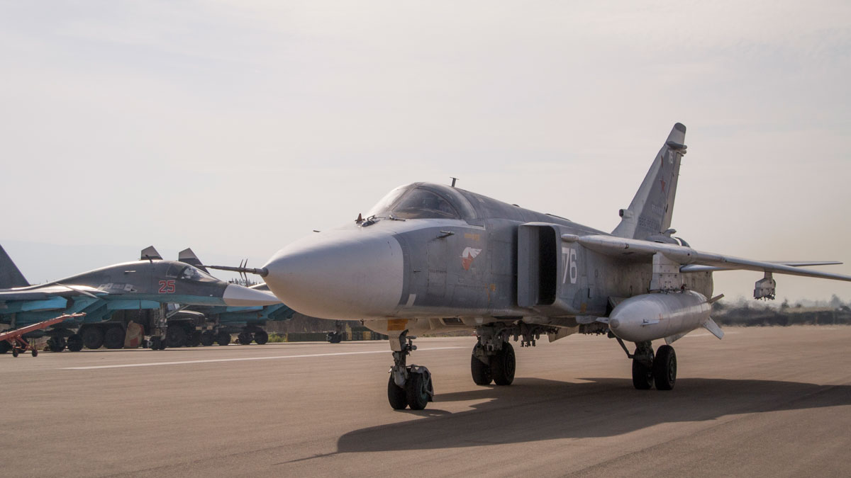 In this file photo taken on Thursday, Oct.  22, 2015, A Russian war plane, foreground, taxies past two two others at Hemeimeem airbase, Syria. The Pentagon said on Tuesday, Nov. 3, 2015, that Russia has a new Syrian base.