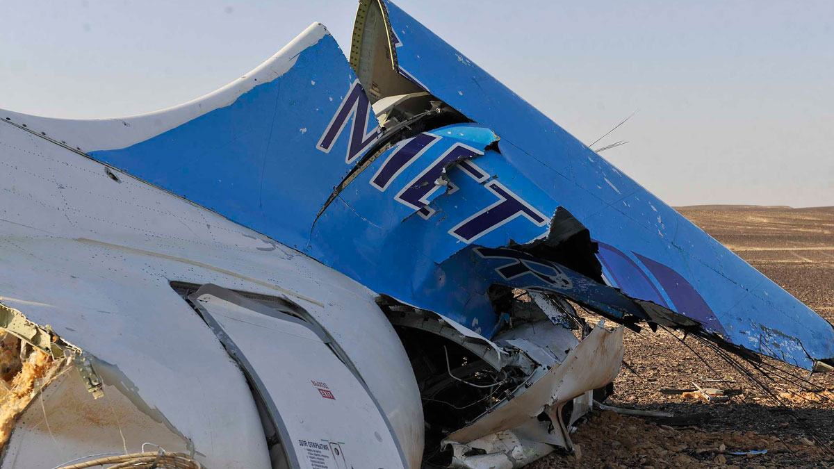 This photo released by the Prime Minister's office shows the tail of a Metrojet plane that crashed in Hassana, Egypt on Saturday, Oct. 31, 2015. The Russian aircraft carrying 224 people crashed Saturday in a remote mountainous region in the Sinai Peninsula about 20 minutes after taking off from a Red Sea resort popular with Russian tourists, the Egyptian government said. There were no survivors.