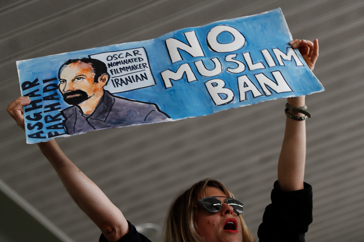 A demonstrator in San Francisco holds a sign in protest of an executive order placing travel restrictions on those from certain Middle Eastern and North African countries and restricting refugees from entering the U.S.