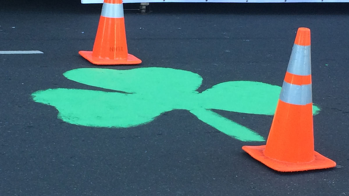 Crews painted shamrocks on the street ahead of the New Haven St. Patrick's Day Parade.