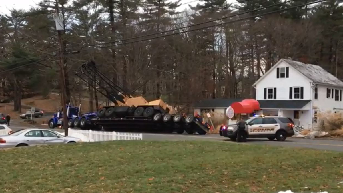 A trailer carrying a crane tipped over on Hopmeadow Street (Route 10) in Simsbury Tuesday afternoon.